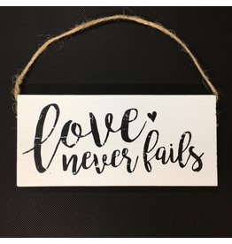 Lyla's: Clothing, Decor & More Love Never Fails Wood Sign