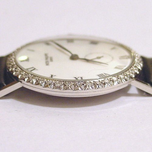 Patek Philippe Circa 1930 Solid 14kt. White Gold with Forty-Four Diamond Bezel