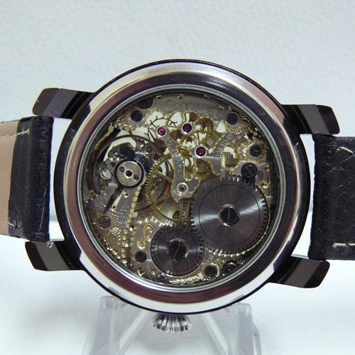 Omega Fusion of a Swiss Antique Movement & a Modern Skeleton Case