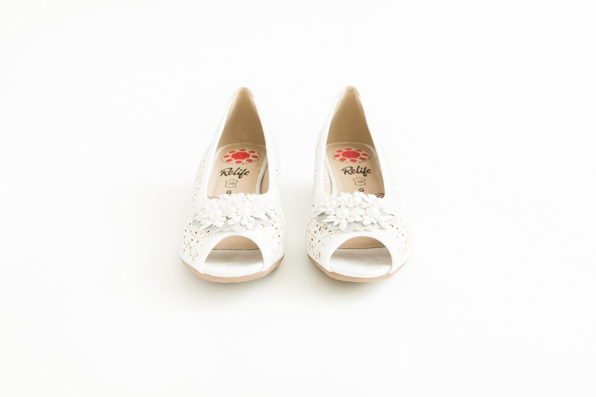White Perforated Pump with Rose Detail