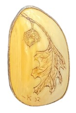 carved pendant leaf and acorn