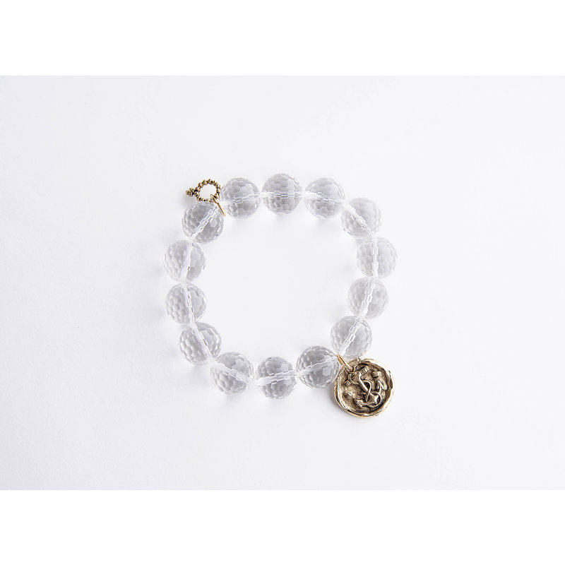 PowerBeads by Jen Faceted clear cut quartz paired with a bronze wax seal anchor