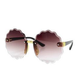 Tiny Treats & Zomi Gems Frameless Round Sunglasses