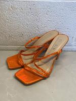 She & in orange square heels 7.5