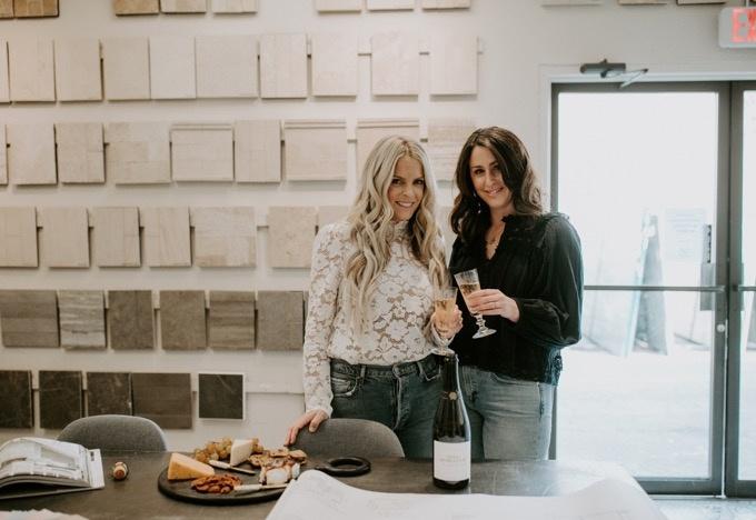 Chelsea Miller and Erika Altes celebrating after a long day designing