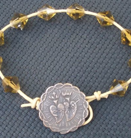 MG Rosary MG Rosary: Handcrafted Topaz Crystal Bracelet w/ Bronze Button Clasp and Leather Chord.