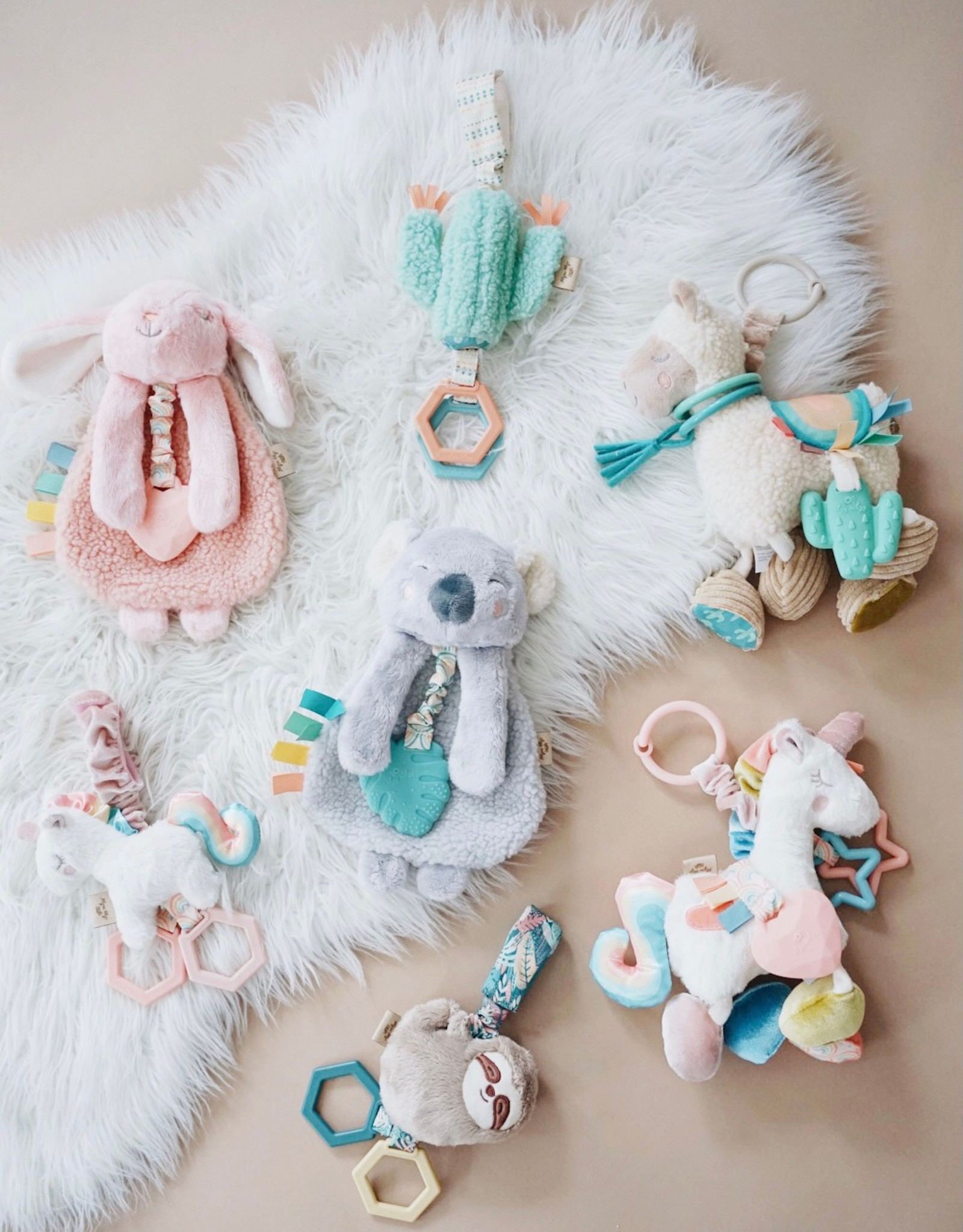 Itzy Ritzy Link & Love Unicorn Activity Plush Silicone Teether Toy
