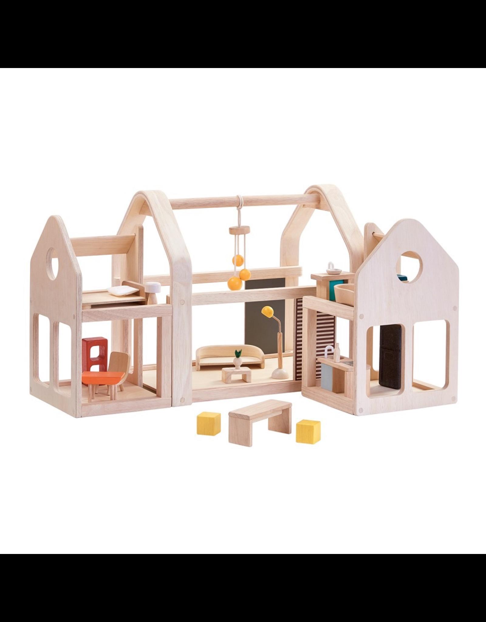Plan Toys Slide N Go Dollhouse By Plan Toys