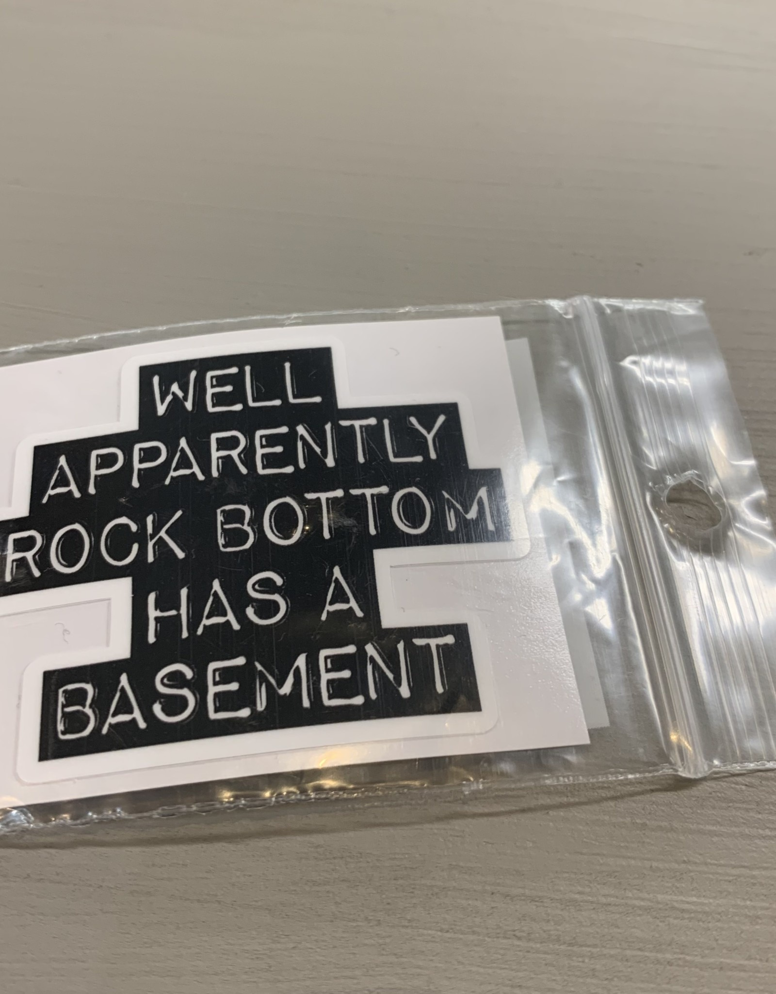 ROCK BOTTOM BASEMENT STICKER (CELL)