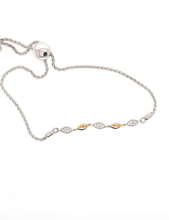 Diamond (0.13 ctw) and gold bolo bracelet, sterling silver & 14k yellow gold