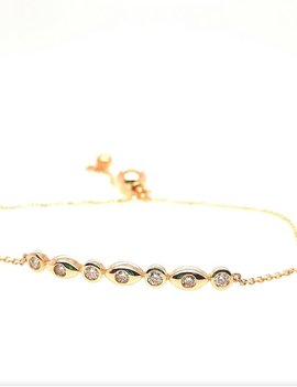 Diamond (0.20 ctw) bezel set bolo bracelet, 14k yellow gold