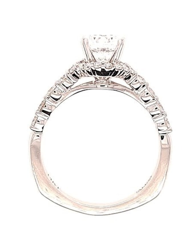 Diamond (0.56 ctw) halo setting, 14k white gold, shown with a cz center