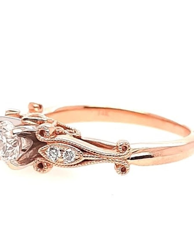 Diamond (0.38 ct center F-G/SI3, 0.43 ctw) antique style setting, 14k rose gold