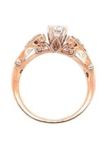 Diamond (0.38 ct center F-G/SI3, 0.43 ctw) antique style setting, 14k rose gold