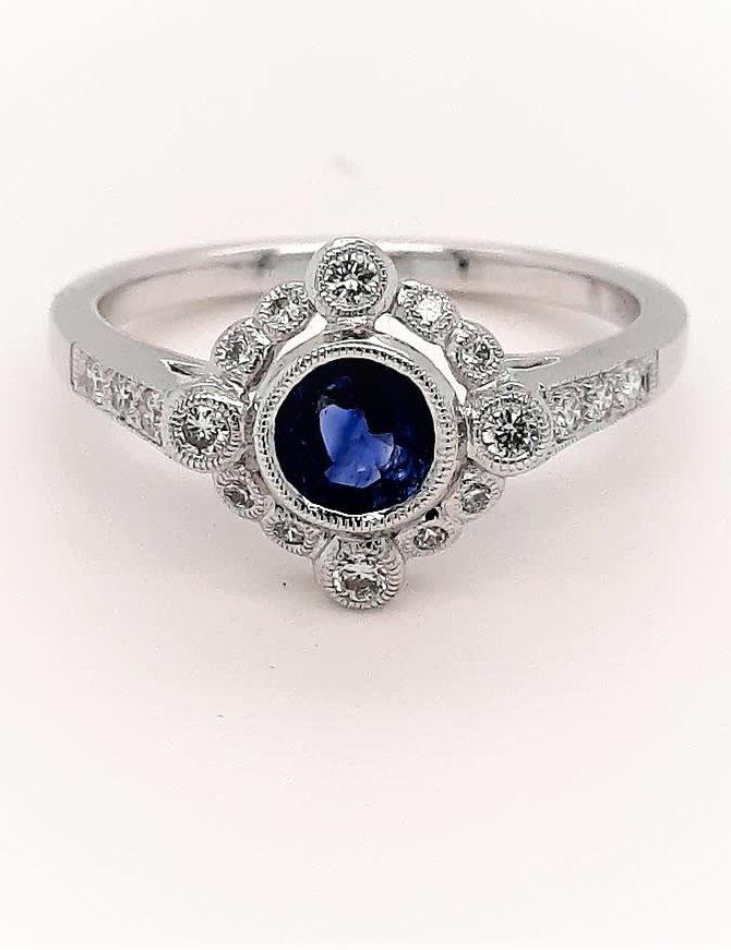 Sapphire (0.59 ct) & diamond (0.23 ctw) antique style ring, 14k white gold