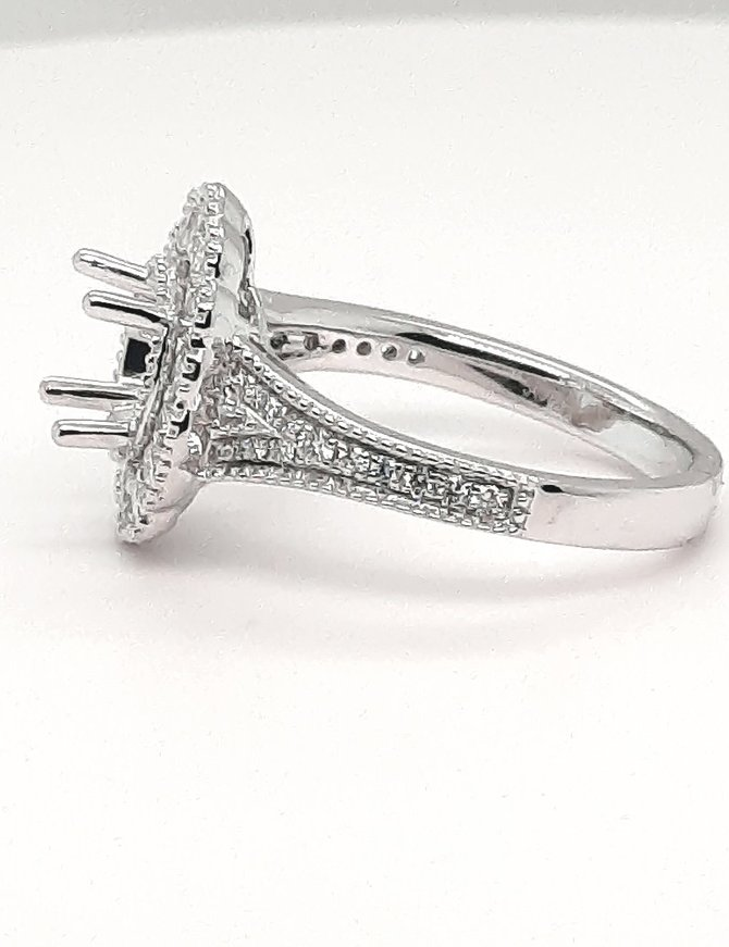 Diamond (0.64 ctw) fluted halo with beaded edge setting, platinum