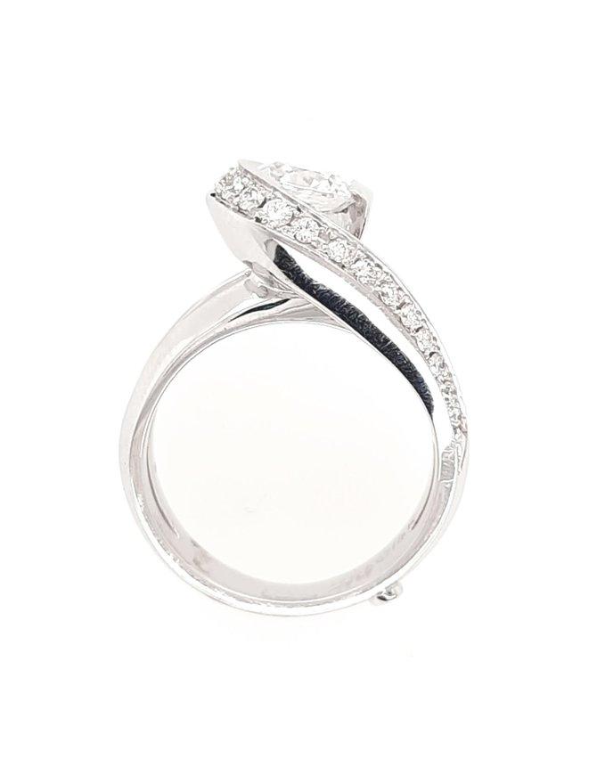 Diamond (0.24 ctw) swirl setting, 14k white gold, shown with a cz center