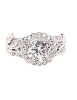 Diamond (0.37 ctw) sculpted halo setting, 18k white gold, shown with a cz center, center stone not included