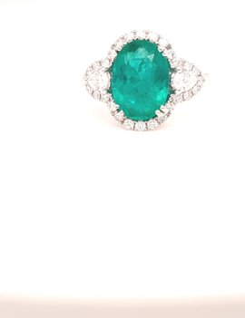 3.00ct emerald, 0.63ctw diamond oval ring with halo, 18k white gold