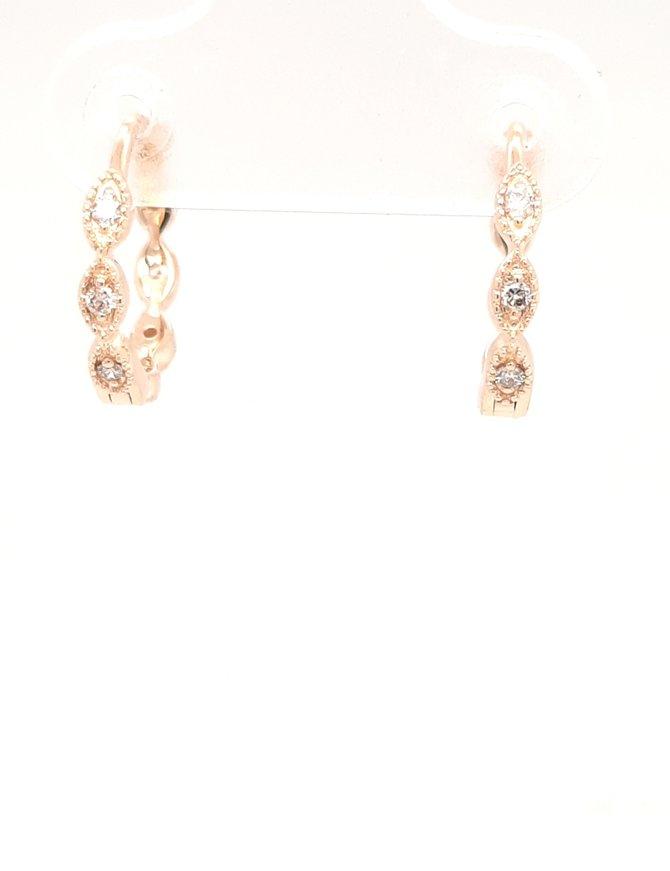 Diamond (0.16ctw) twist huggie hoop earrings 14k yellow gold