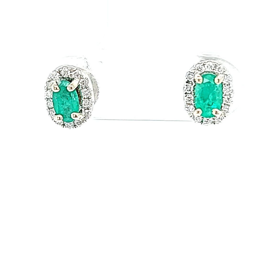 14KW Oval Emerald Stud Earrings With a Diamond Halo .15cttw