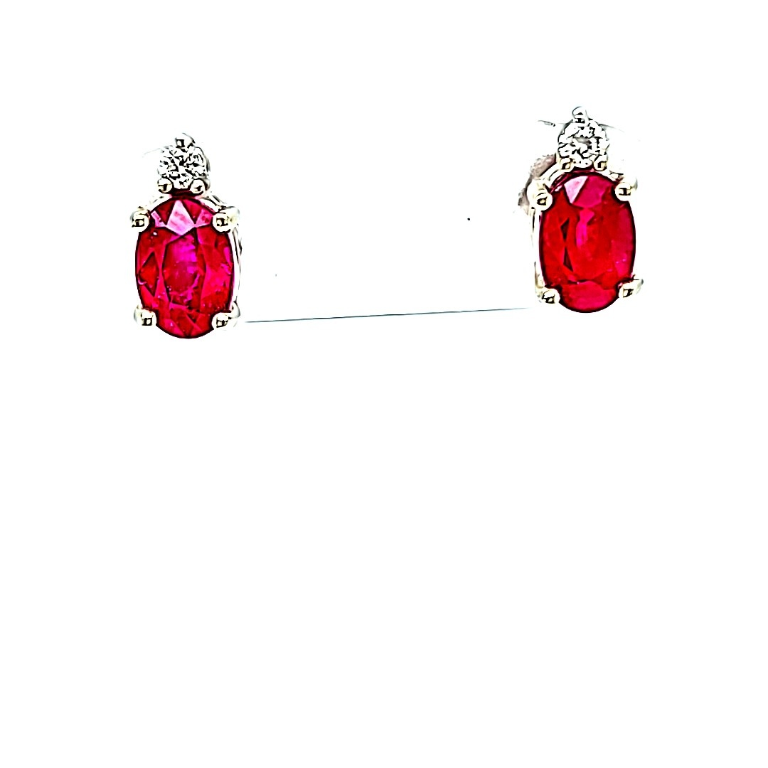 14KW 0.53cttw Oval Ruby and Diamond Accent Stud Earrings