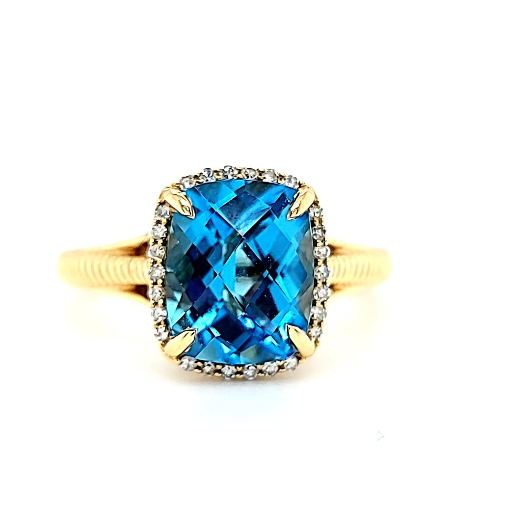 14KY Blue Topaz Ring With a Diamond Halo