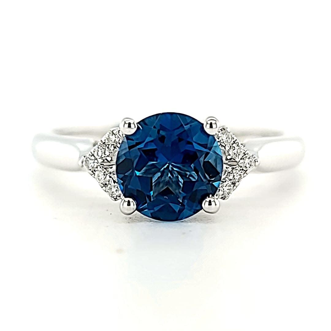 Cirari 14KW 1.56CT London Blue and Diamond Ring .06tw