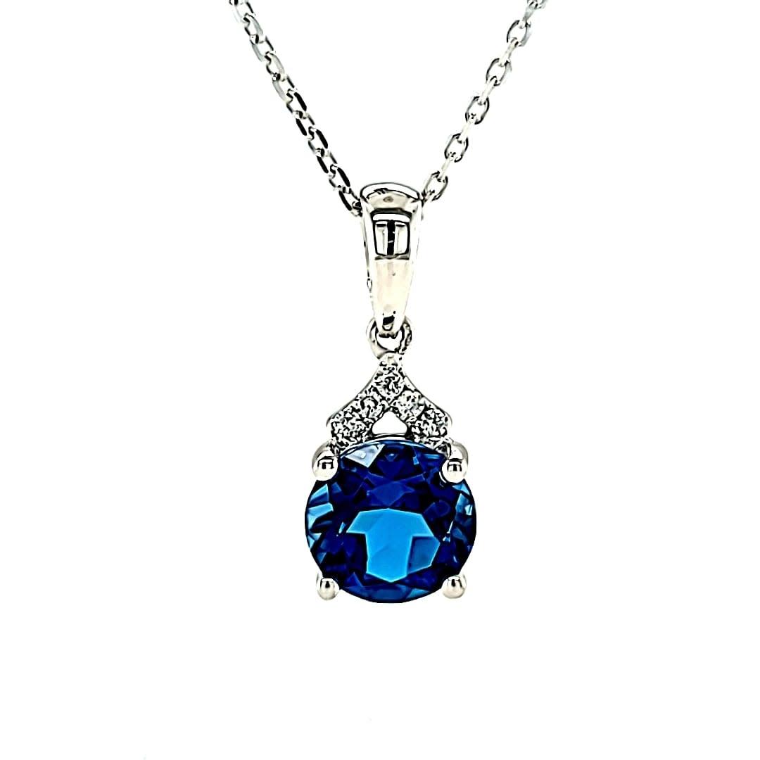 Cirari 14KW 1.61CT London Blue Topaz and Diamond Pendant .09tw