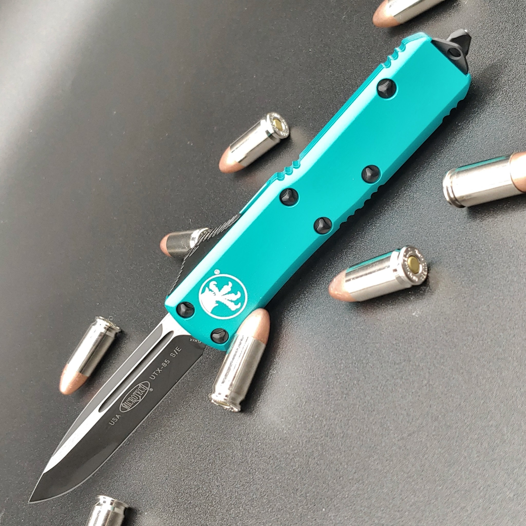 Microtech UTX-85, Turquoise frame,  blade - single edge black standard