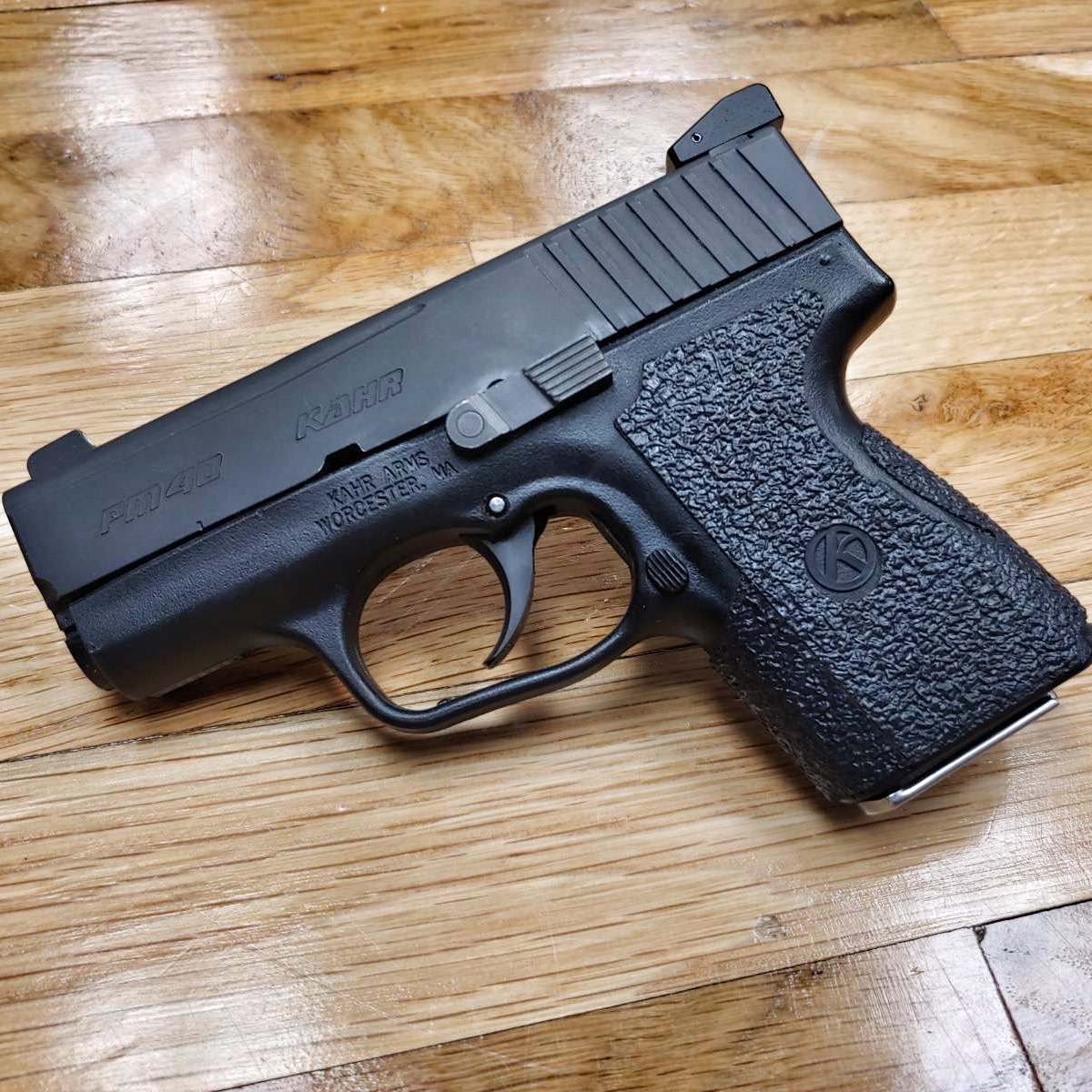 Used KahrPM40, 40 S&W, black, upgraded night sights