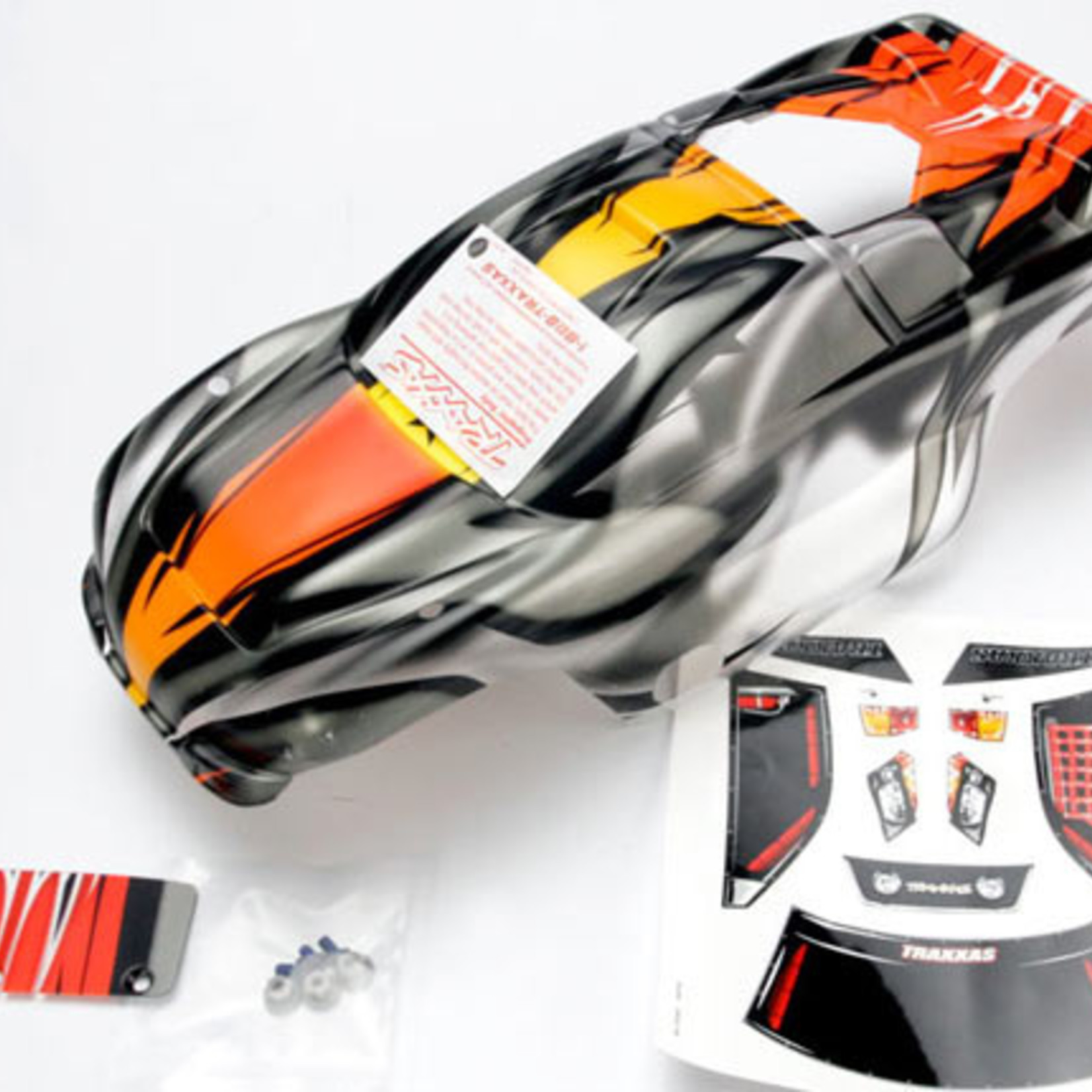 Traxxas TRA4411R Traxxas Body, Nitro Rustler, Prographix (Replacement For The Painted Body. Graphics Are Painted, Requires Paint & Final Color Application.)/Window, Grille, Lights Decal Sheet/ Wing And Aluminum Hardware