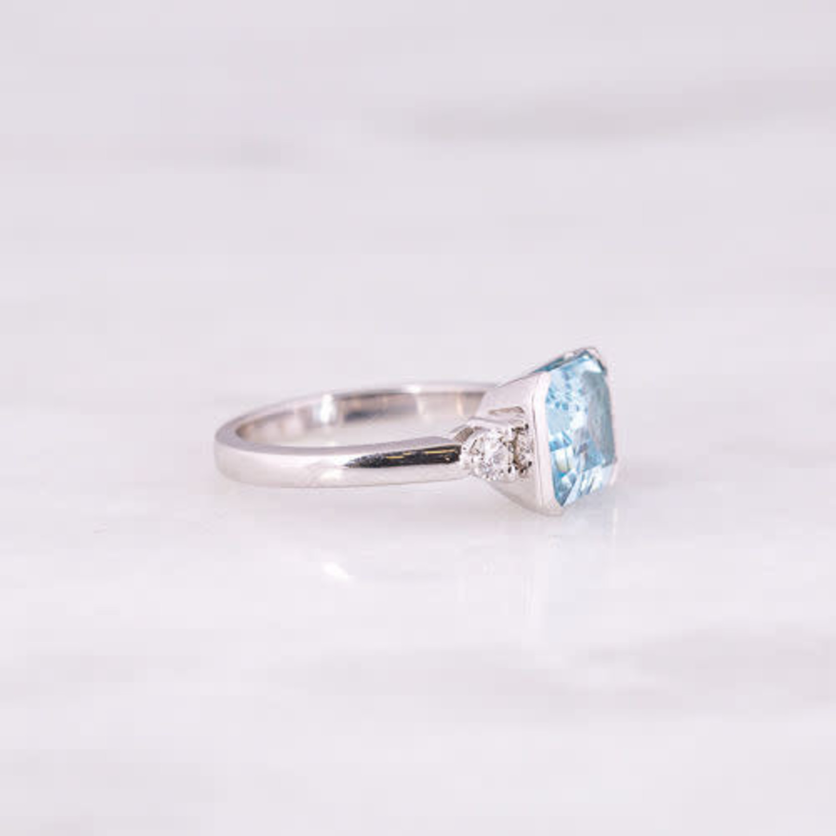 14K White Gold Blue Topaz and Dia 0.20ctw Semi BezelRing