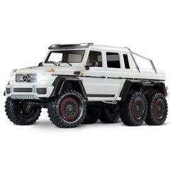 88096-4 - TRX-6™ Scale and Trail™ WHITE Crawler with Mercedes-Benz® G 63® AMG Body: 1/10 Scale 6X6 Electric Trail Truck. Ready-to-Drive® with TQi Traxxas Link™ Enabled 2.4GHz Radio System, XL-5 HV ESC (fwd/rev), and Titan® 550 motor.