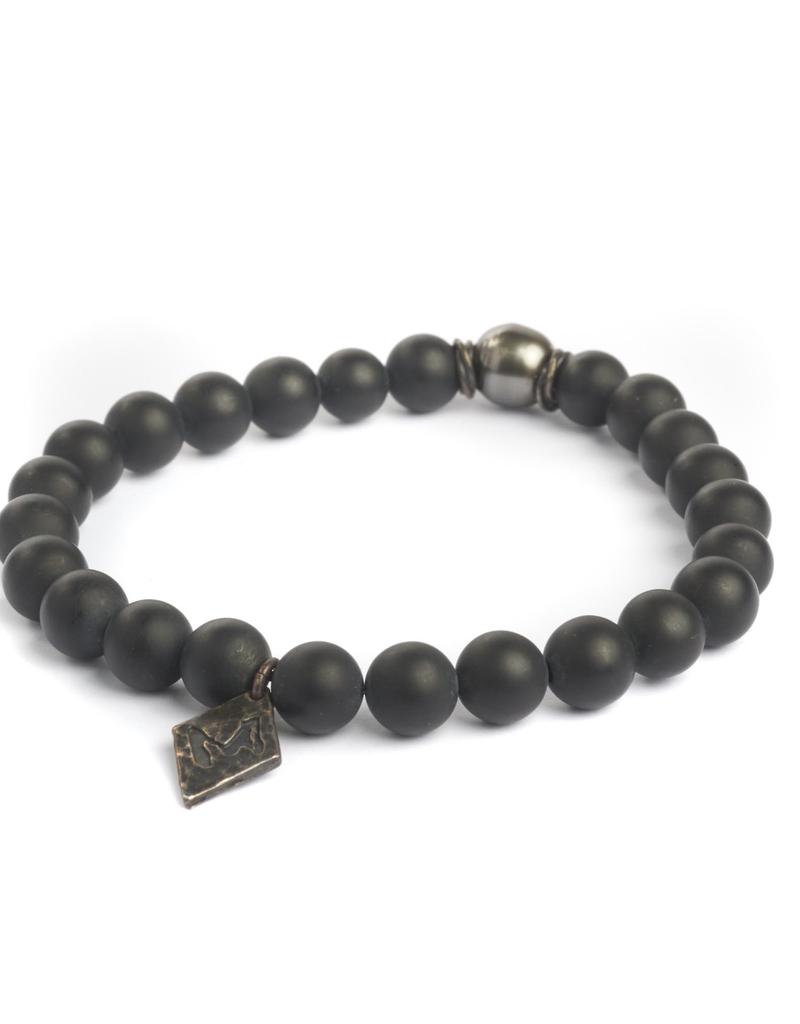 Black onyx beads on elastic cord and Tahitian black pearl bracelet
