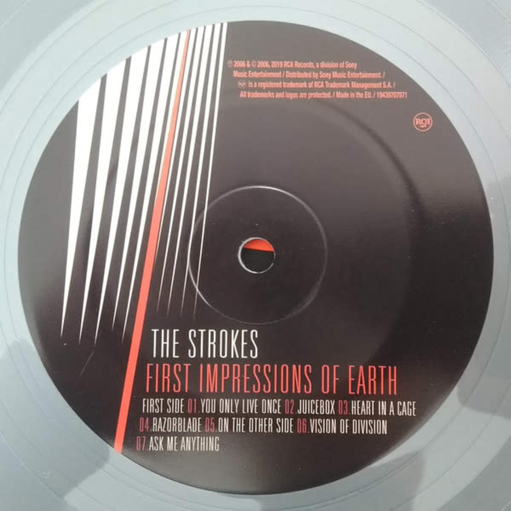THE STROKES FIRST IMPRESSIONS OF EARTH  SILVER VINYL