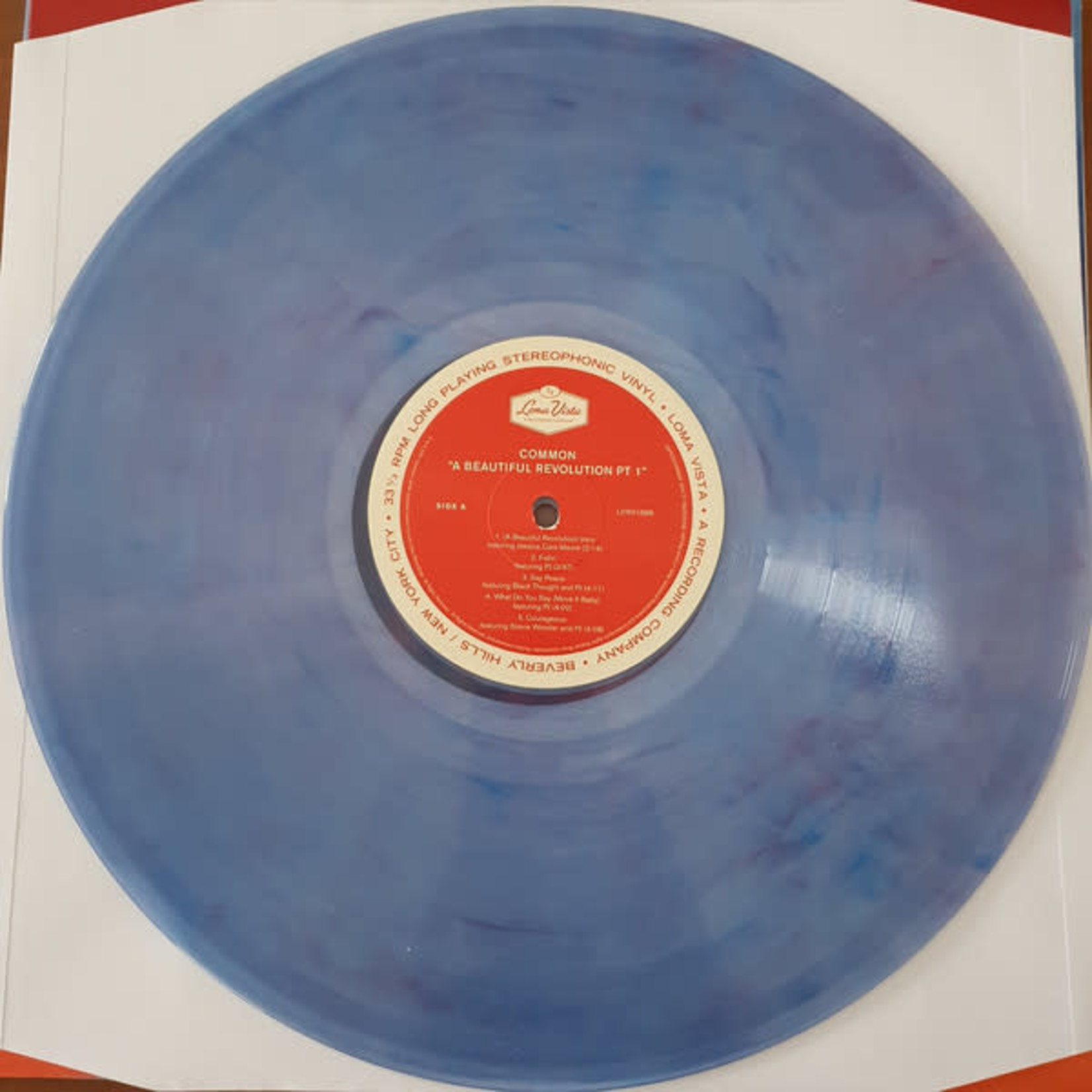 COMMON A BEAUTIFUL REVOLUTION PT. 1  CLEAR W/ RED WHITE AND BLUE MARBLE LP