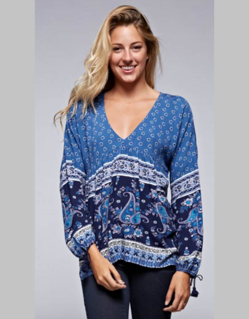 Love Stitch I-10633NCQ A mixed floral print boho top featuring long sleeves with tassel tie arm wrist cuffs and a keyhole back detail.