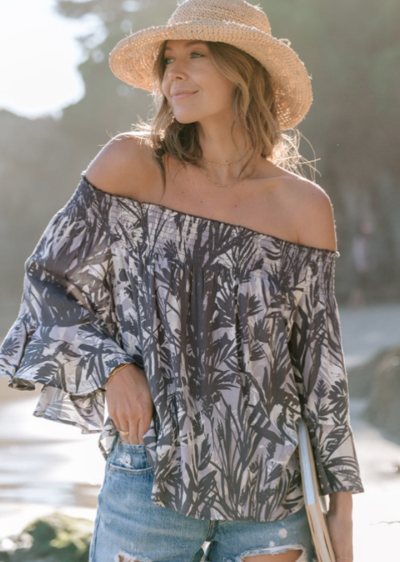 Love Stitch A resort-ready tropical print off the shoulder blouse.