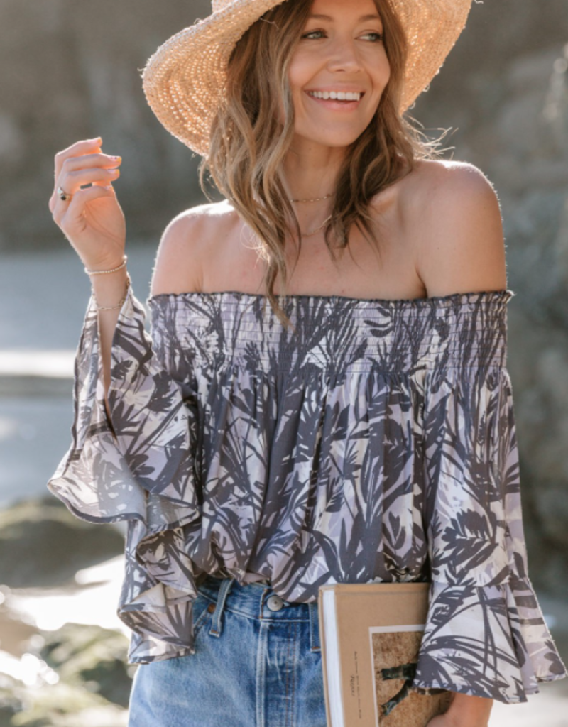 Love Stitch A resort-ready tropical print off the shoulder blouse. Featuring a smocked elastic neckline, ruffled bell sleeves, and a relaxed fit.I-13215W-RFZ-TC