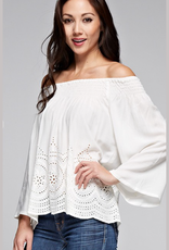 LoveStitch I-10777 A beautiful, bohemian white off shoulder top featuring three quarter bell sleeves, cute eyelet detail, a smocked off shoulder detail, and a scalloped hem.