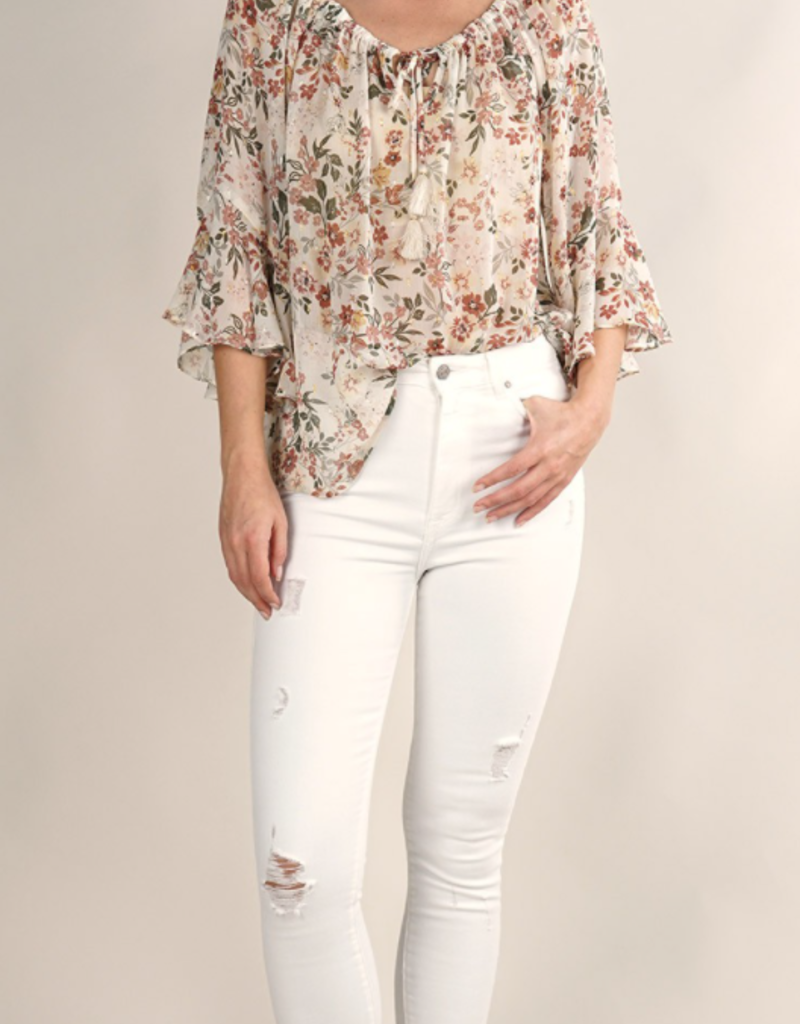 Love Stitch I-13103W-QZZ-EL Sheer floral peasant top with shirred neck, neck tassel ties, and three-quarter flutter sleeves.