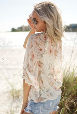 Love Stitch I-13103WL-RCM-EL Sheer floral peasant top with shirred neck, neck tassel ties, and three-quarter flutter sleeves.