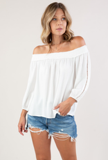 Love Stitch I-13278W-RFO Off the shoulder top with lattice trim detail. Features a 3/4 sleeve and elastic cuffs.