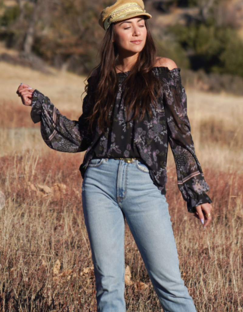 Love Stitch I-13403WL-RHB-ZC Bohemian floral off shoulder top. Featuring long voluminous sleeves, a flounce wrist cuff, a smocked elastic neckline, and a relaxed fit. Lining attached.