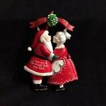 Mr & Mrs Claus Under Mistletoe