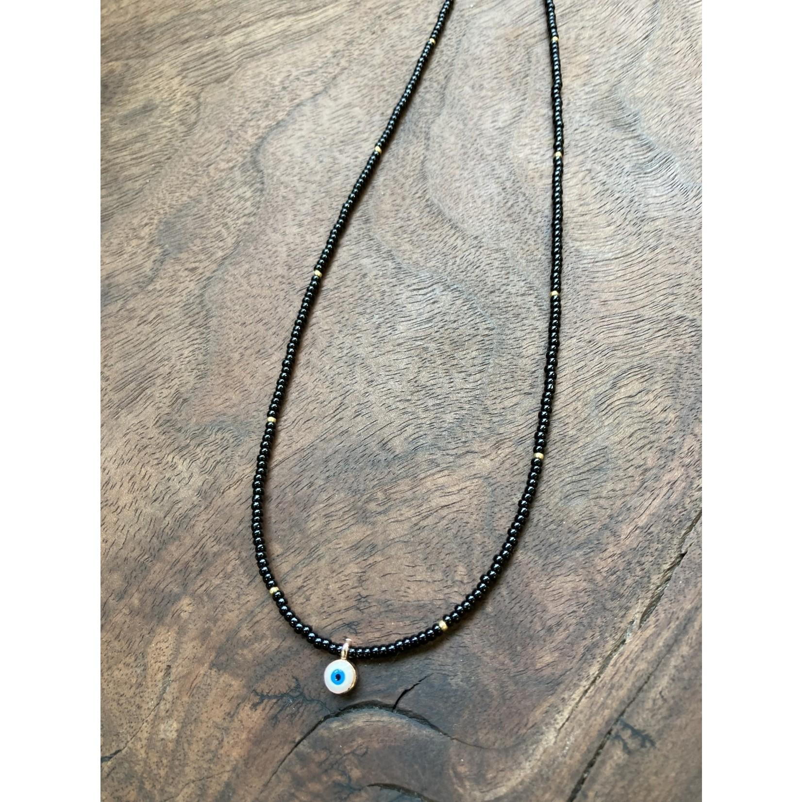Maureen Oehrle Maureen Oehrle | N36 Black Seed Beads with tiny white evil eye Pendant