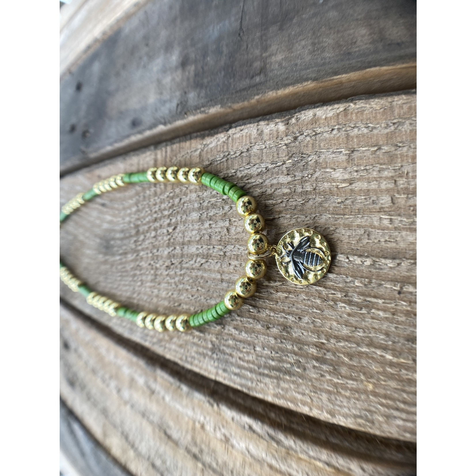 So Me So Me Designs| Honey Bee: Heishi green beads, paired with golden hematite and a bee pendant, necklace
