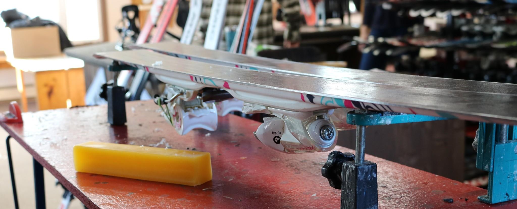 Ski on table with bar of wax