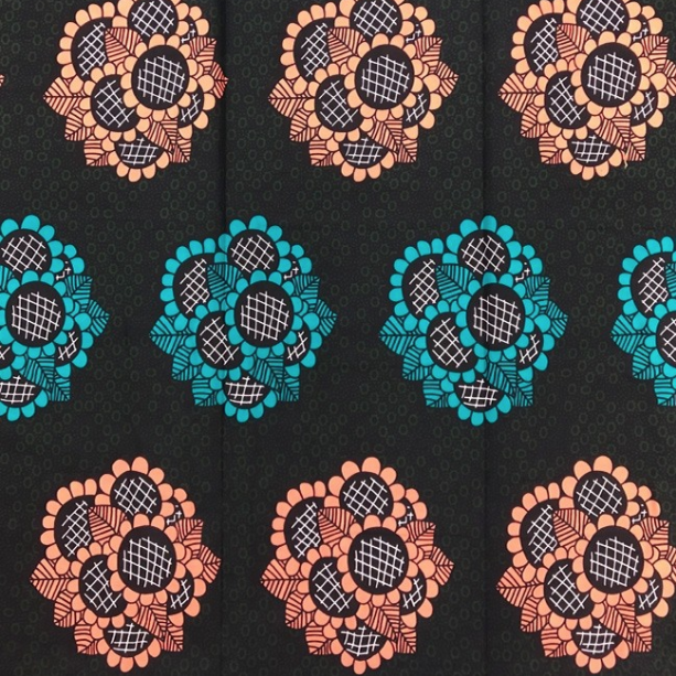 Fabrics USA Inc African Wax Print -  Peach and teal bouquets on olive and black background